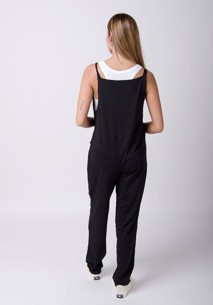Full rear pose showing adjustable straps and back pockets.
