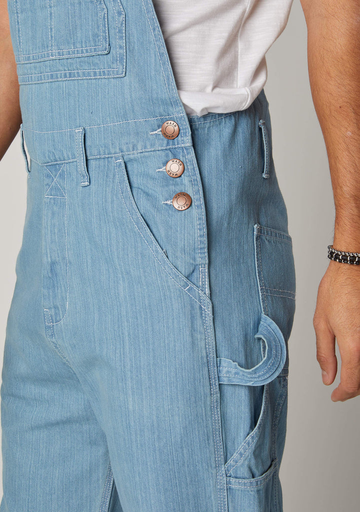Close-up of Maddox bib-overalls for men showing the side button fastening, hammer loop and rule pocket.