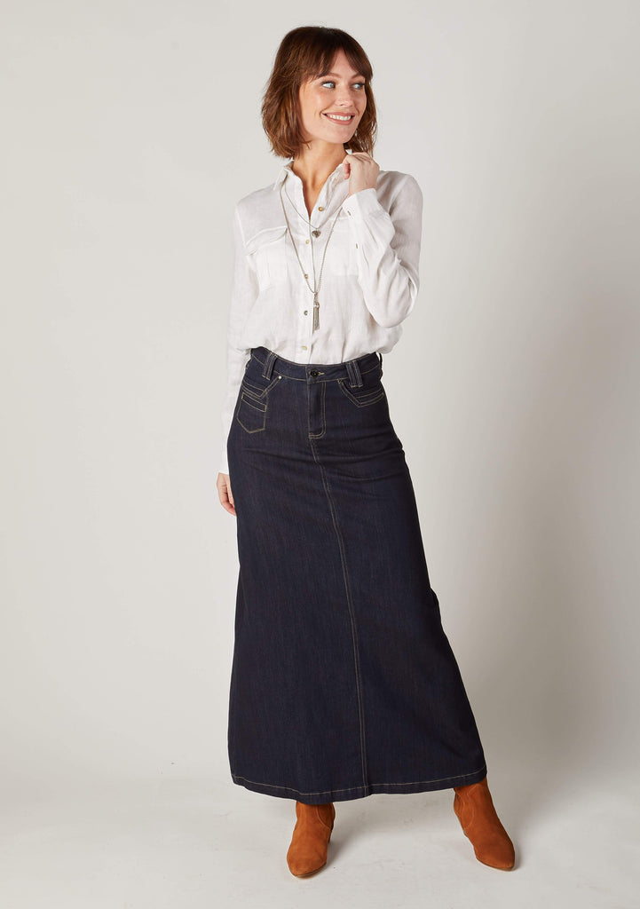 Full-length informal front pose of Natalie long dark blue denim skirt.