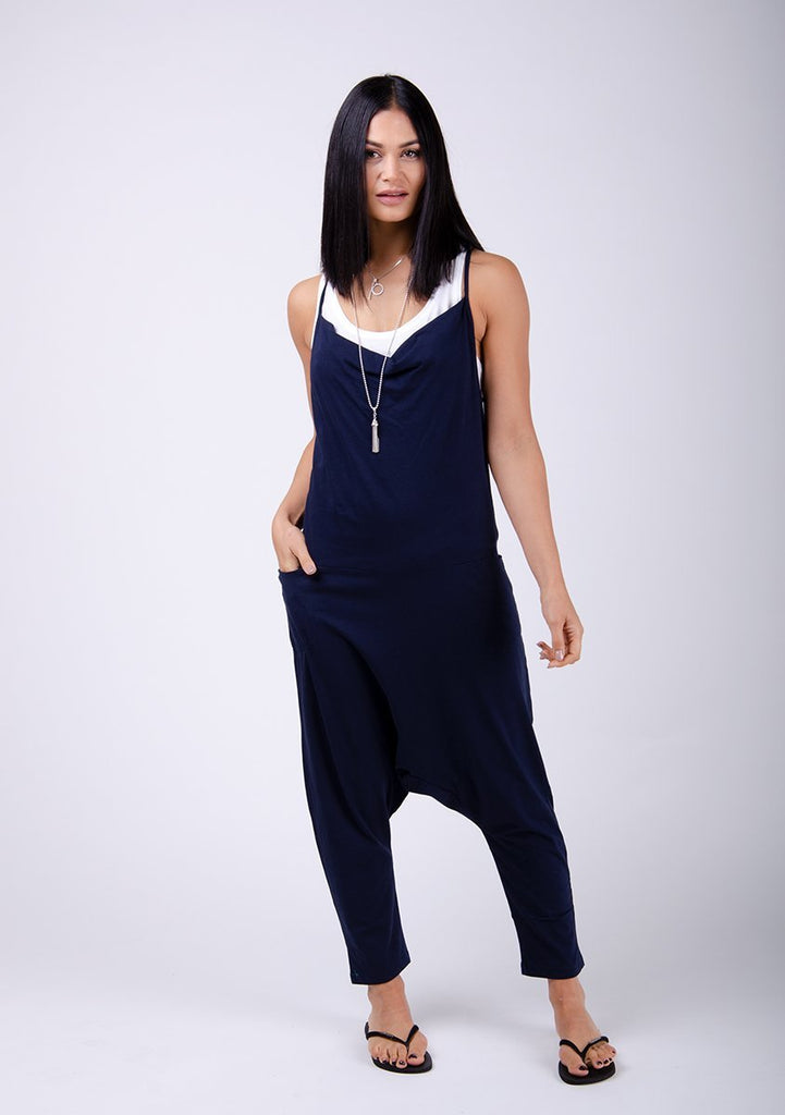 Full frontal pose with hips swaying to her right, wearing Cindy-style navy-blue jersey jumpsuit.