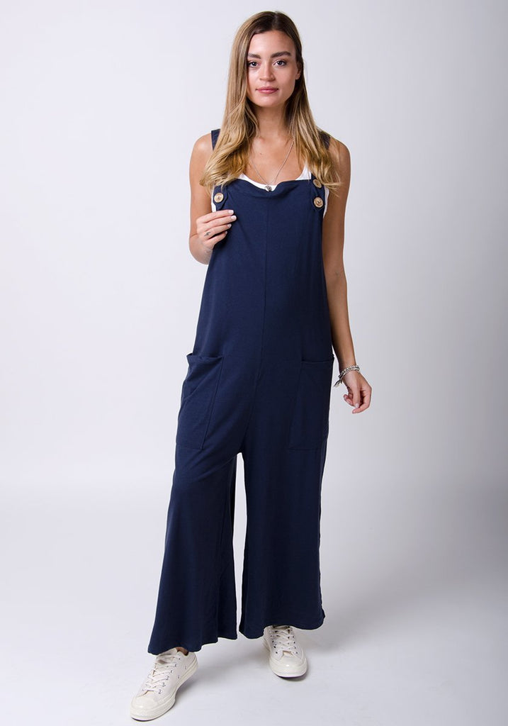 Full-length pose wearing Amber-style, navy cotton jersey, wide-leg overall. Right leg highlighting loose fitting.