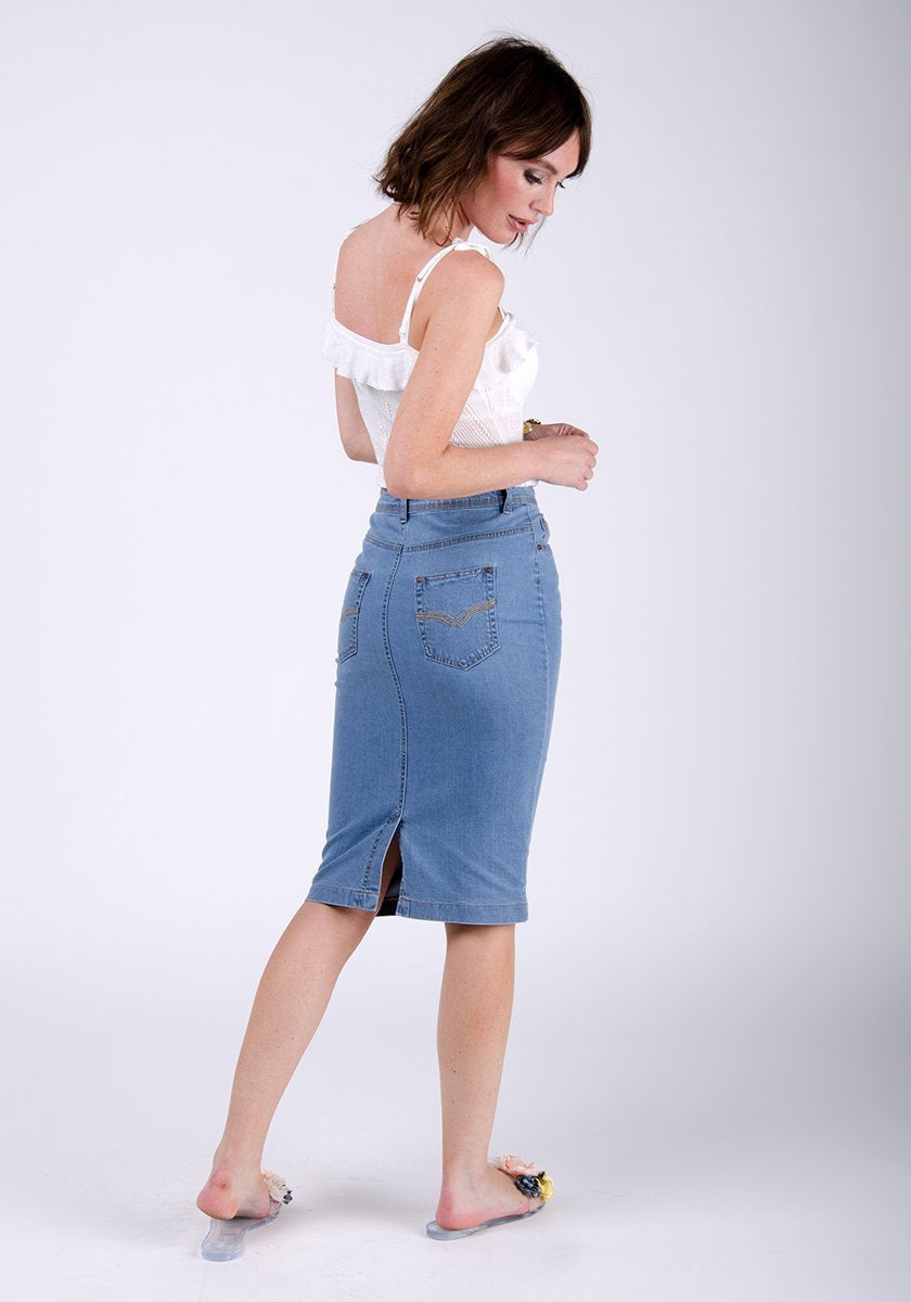 Full-side pose showing back pockets, back-split and pencil skirt silhouette.