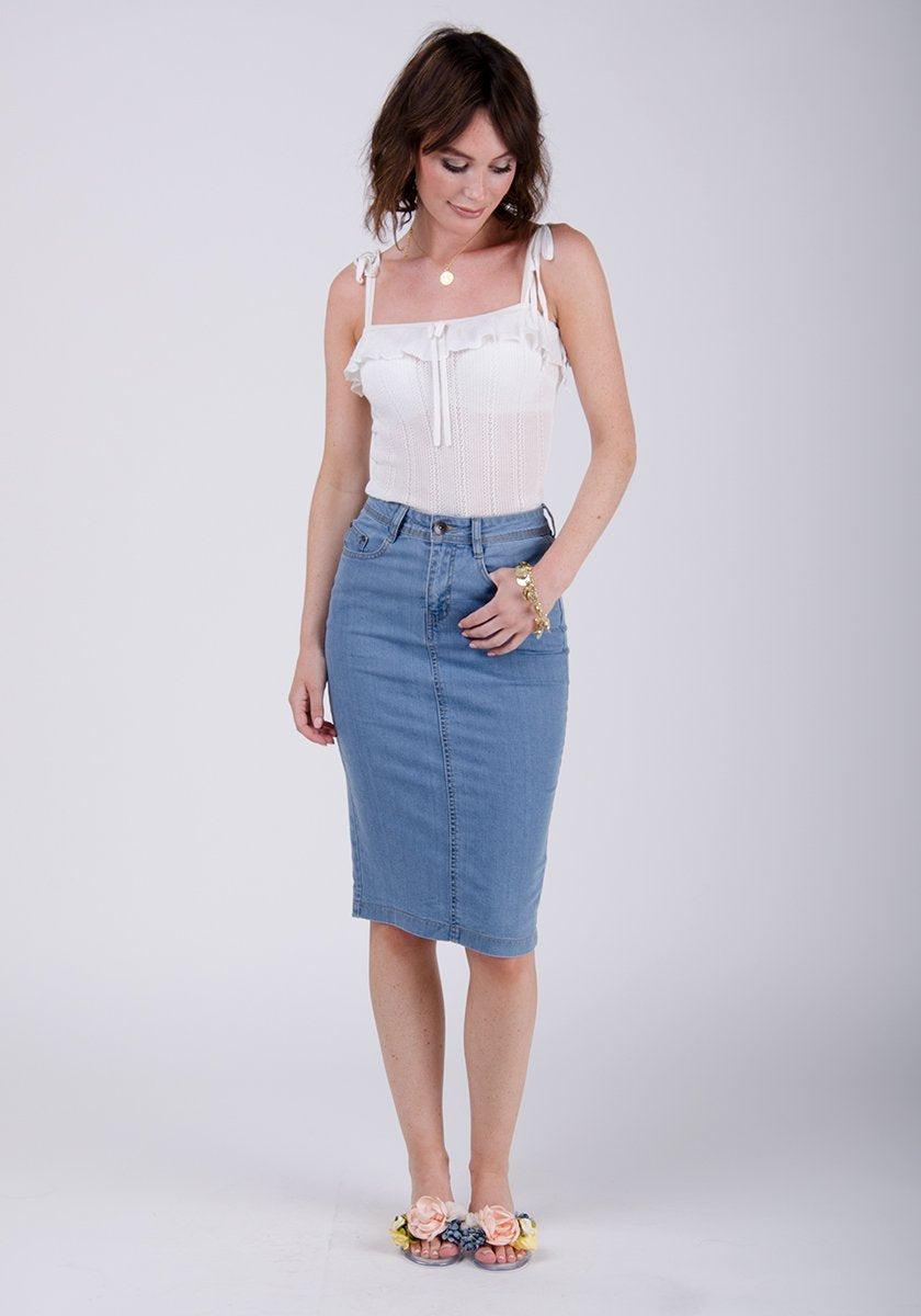 Full-front pose wearing stretch denim pencil skirt.