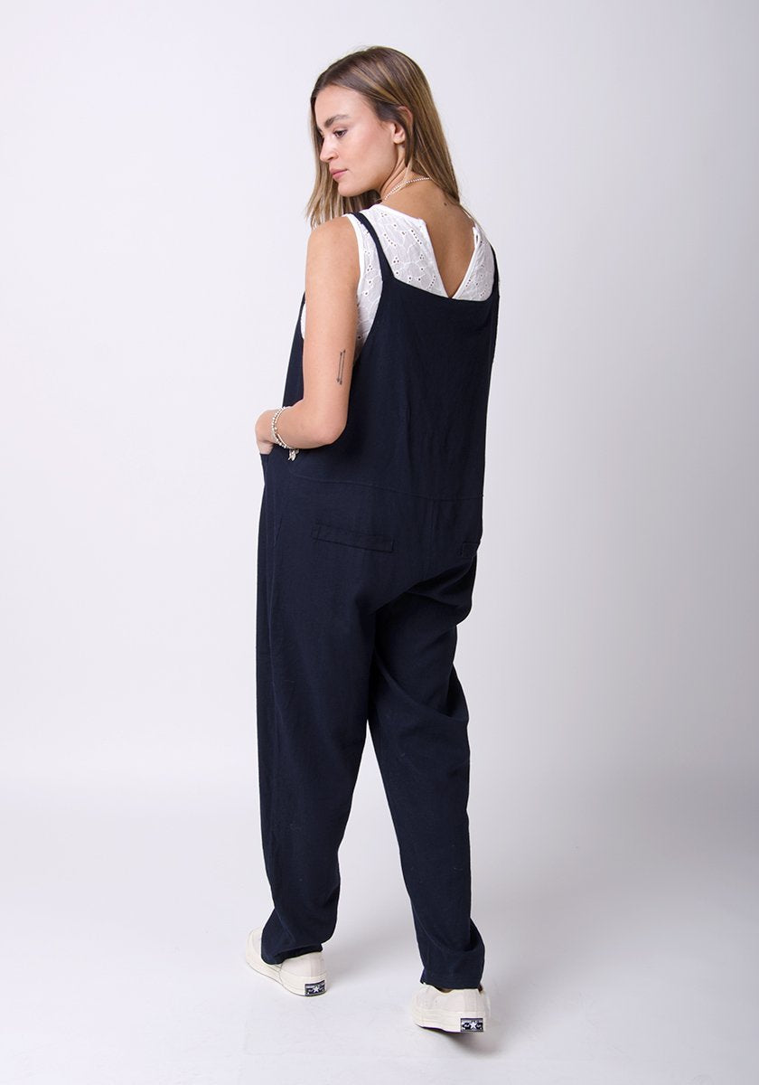 Full-rear pose showing adjustable straps and back pockets.