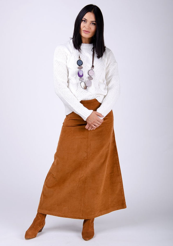Full-frontal pose leaning on left leg wearing autumn style, brown corduroy skirt.