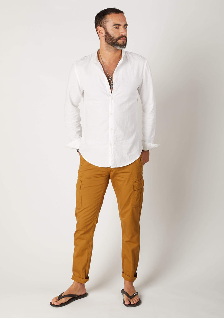 Front full length pose of Radcliffe gold colour organic cotton cargo trousers for men