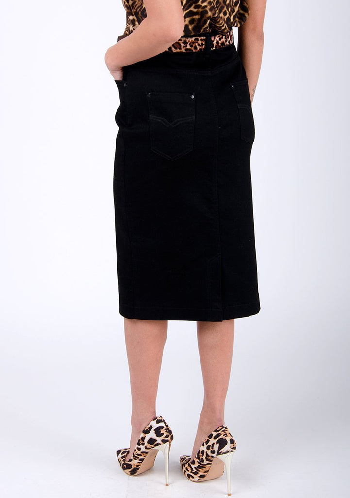 Half-rear pose focussed on back of smart, black denim midi-skirt.