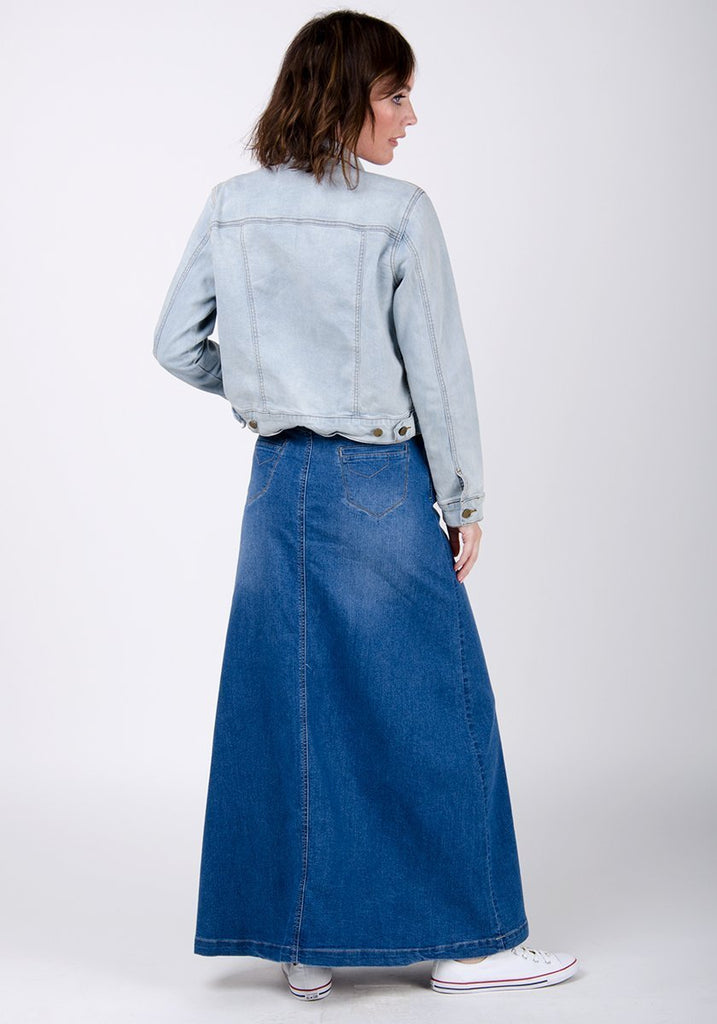 Full rear pose wearing cotton-polyester denim skirt with flared hemline.