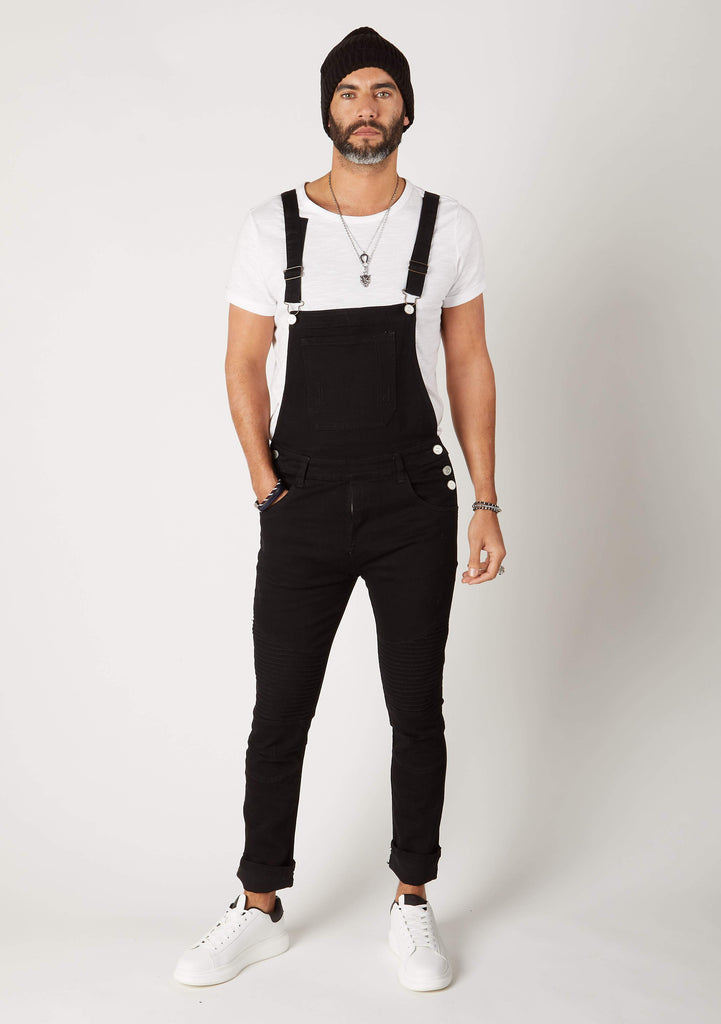 Full frontal pose with right hand in front pocket wearing narrow silhouette, Trafford-style skinny bib-overalls.