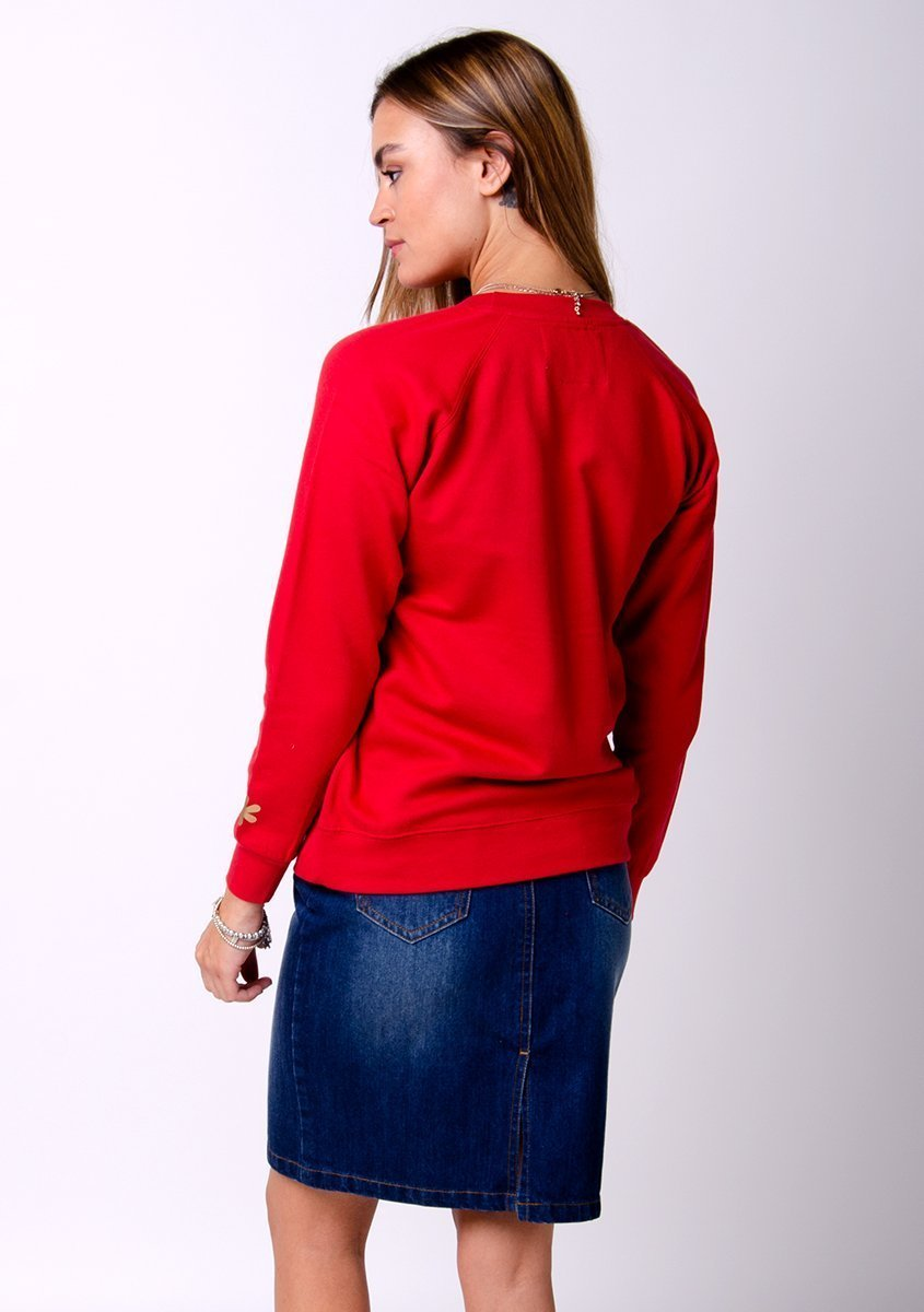 Two-thirds rear pose with hand in right pocket, wearing versatile, Nadine style dark wash denim skirt.