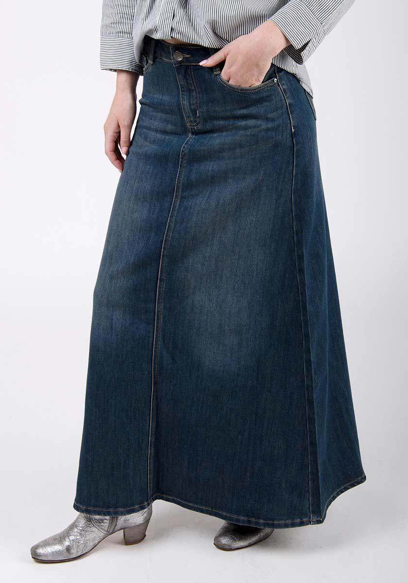 Half-frontal-side pose with hand in front pocket highlighting denim texture and panels.
