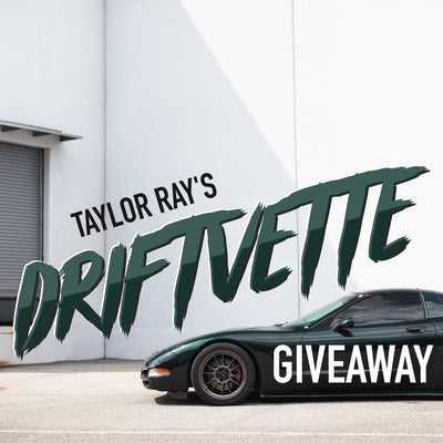 Taylor Ray's Driftvette Giveaway mobile banner showing his 2001 Chevrolet Corvette in racing green parked in front of a loading dock with a white washed wall in the background