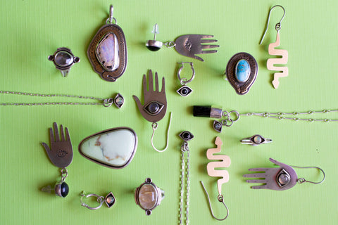 flat lay of jewelry pieces on green background