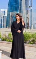 A pleated black closed abaya, kimono