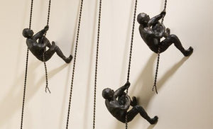 decorate in style with the climbing man sculpture from attica