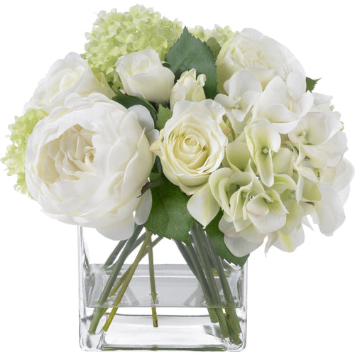White summer rose and hydrangea bouquet in glass cube