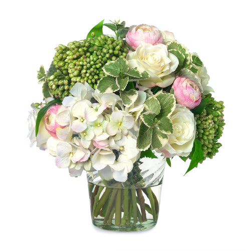 Oregano, rose and hydrangea bouquet in green swirl vase