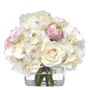 Pink and white hydrangea bouquet in glass cube