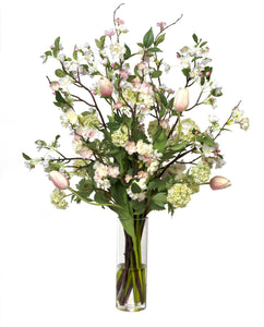Pink blossom bouquet in glass cylinder