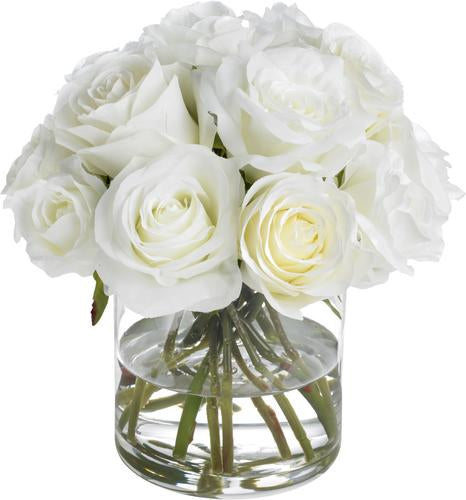 White roses in glass cylinder