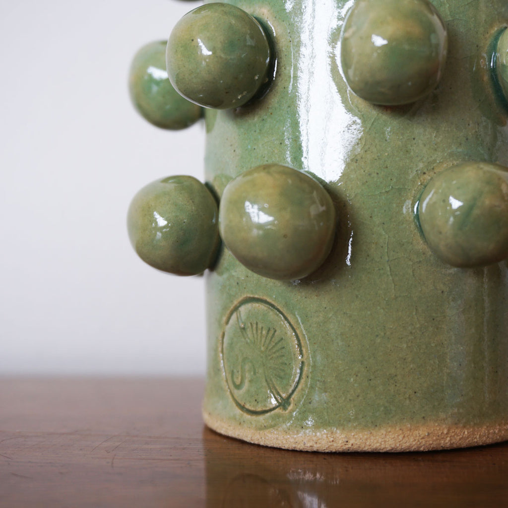 green bobble vase detail