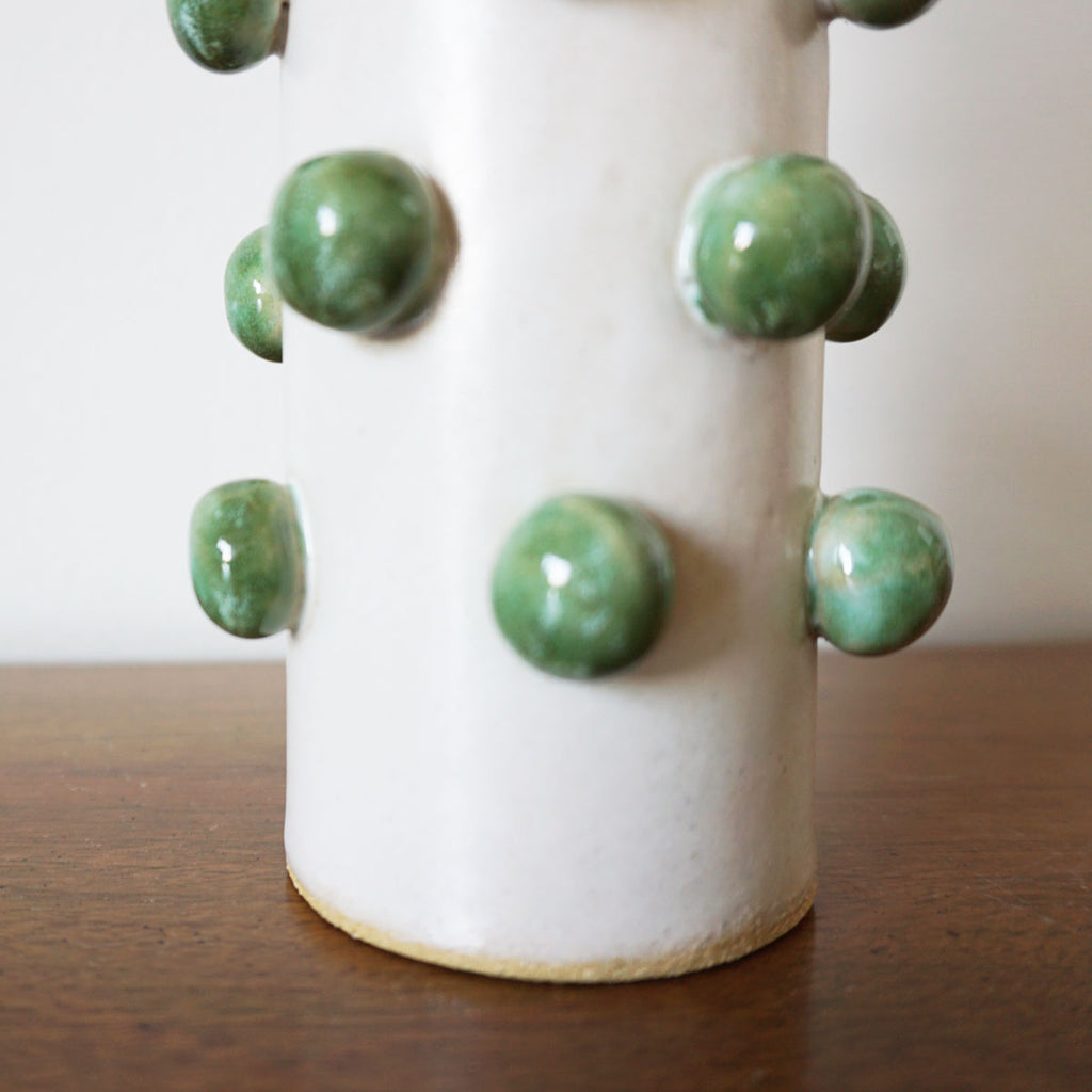 green dotted vase