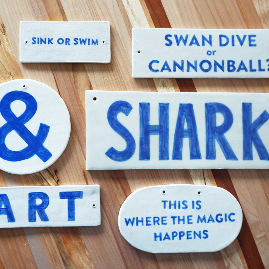 ceramic hand drawn signs by Salto