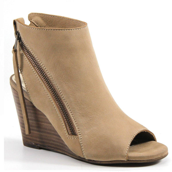 The IN BETWEEN wedge sandal is both sophisticated and playful. It features a 3.25 inch stacked wedge heel, dual slanted zip closure, open toe, and slingback silhouette. The basketweave leather upper adds a fashion-forward touch to multiple looks.
