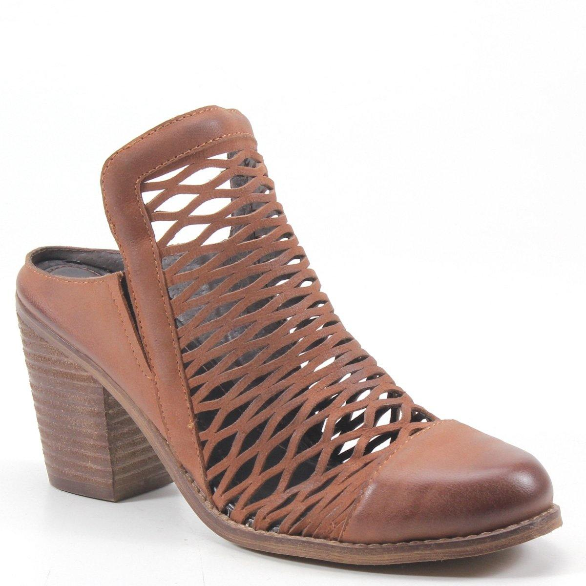This stylish slip-on has an intricate cage cut out design that covers the leather upper of the silhouette. A cushioned insole, stacked heel, and round covered toe that will take your casual looks to new heights.