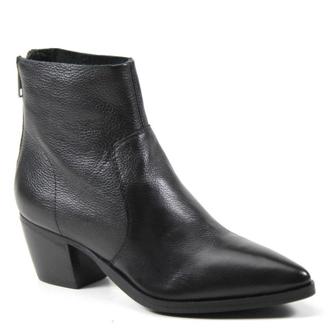 A minimalist ankle boot finished with a clean-cut topline sits on a sleek block heel. Sharp top stitching wraps the genuine leather upper and meets a pointed toe, and rear zipper entry.