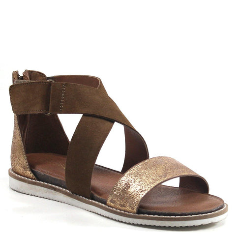 Maximize style and comfort with this stylish sandal that mixes neutral ranges and metallic tones. FLIP TOES by Diba True features leather straps that create a decorative cut- out design fit with an adjustable closure. A cushioned footbed adds everyday comfort to a versatile sandal.