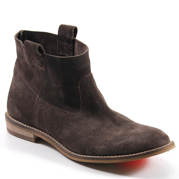 PLANE TO SEE by Diba True has impeccable topstitching that outlines the suede upper. A well-cushioned, comfortable bootie with a clean silhouette has pull tabs to assist with entry.