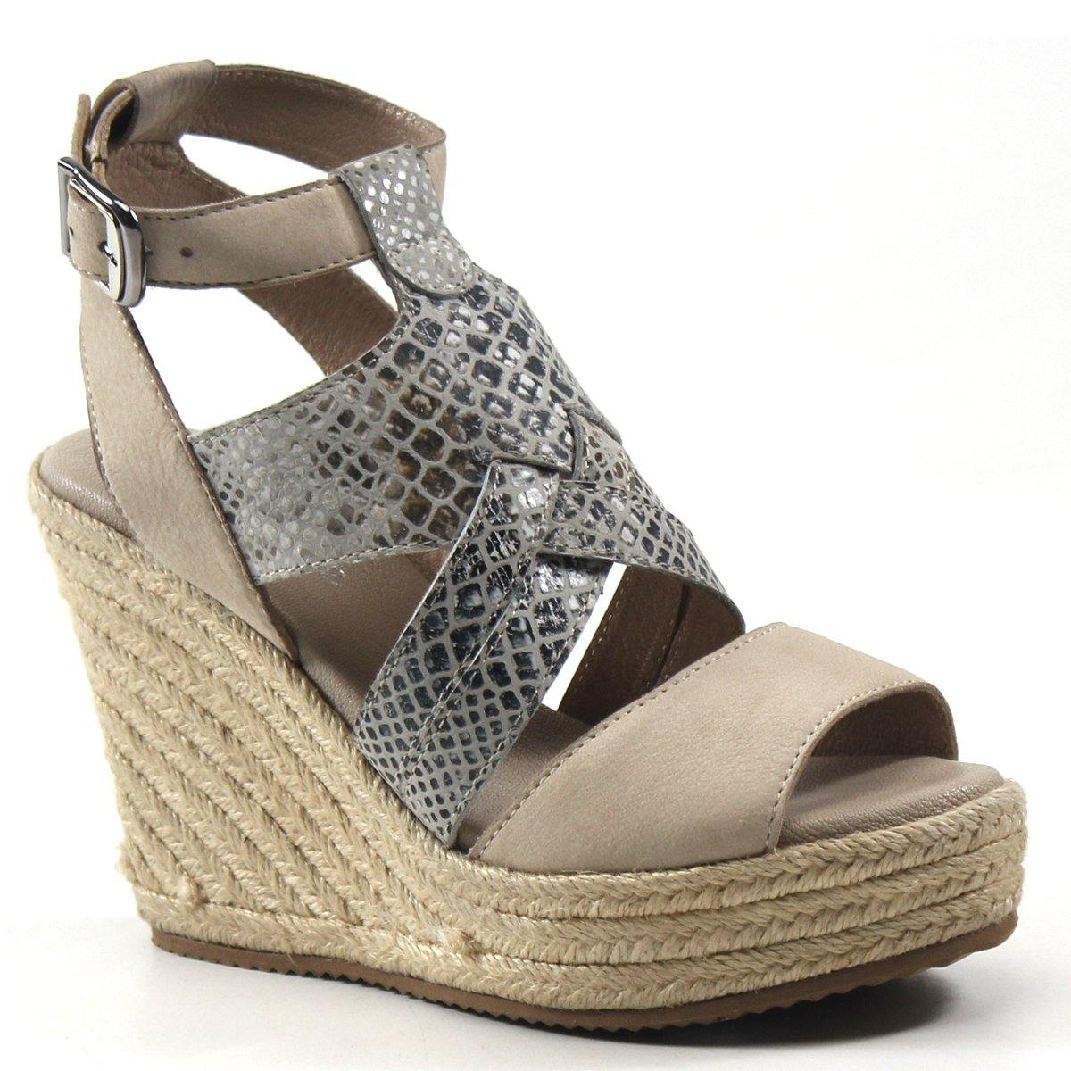 A melting pot of textures takes this espadrille-inspired platform wedge to the next level. Neutrals meet with earthy tones as snakeskin makes a bold statement creating a woven cage effect across the cutout vamp. HUG GABLE by Diba True mixes neutral pallets with natural and organic textures beautifully.