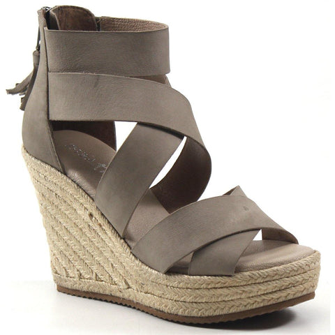 An espadrille-inspired wedge with stylish leather cross- straps designed to take you to new heights. HI FLIGHT by Diba True is a must-have addition for your collection with a neutral range. A back zipper with whimsical tassel detail compliments the natural fibers in this platform wedge design.