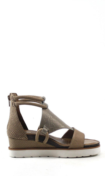 This 2- inch platform wedge sandal is covered in embossed leather/ embossed suede snakeskin. The intricate cut- out design detail and elastic ankle wrap adds a stylish accent and bohemian flair. A padded insole offers comfort without compromising style. An easy back zip closure and open toe adds a relaxed finish to any outfit.