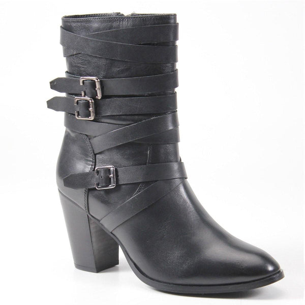The JUST IN boot includes multiple wraparound laces with buckle details and an almond toe to create a fashion-forward silhouette. With a 3.5 inch stacked heel, zipper closure, and soft padded insole, this shoe elevates casual and dressy looks.