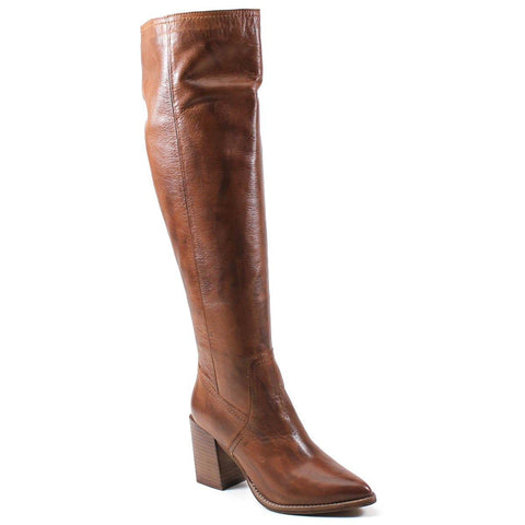 A knee boot of clean lines of leather is elevated by a stacked block heel and partial side zipper for entry.