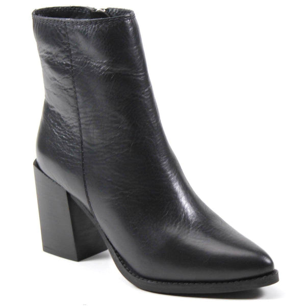 A pointy toe and chunky heel combination elevate the sleek and striking bootie crafted from supple leather called TALL TOES by Diba True. The pointy-toe adds interest to the block heel silhouette complete with an inside zipper and padded insole.