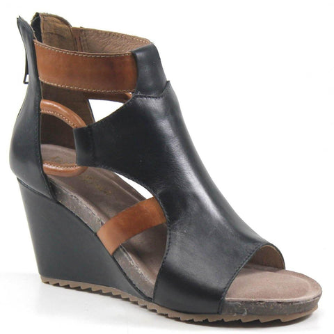 Transition into each season with ease, with sleek side cutouts complimenting the open-toe design that's full of spunk and style. A comfortable wrapped wedge adds height to the leather upper that meets the ankle strap and accents the side cut- out design.