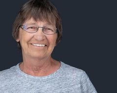 professional headshot of an older women with glasses