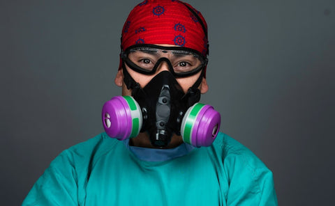 professional headshot of a doctor wearing personal protective gear