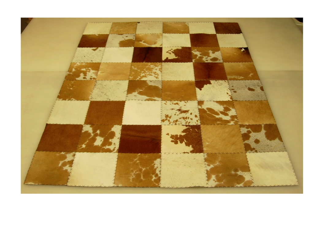 Brown and White Patchwork Hair on Hide Rug