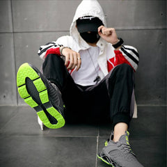 just so white panther sneakers - model sitting with back against a wall