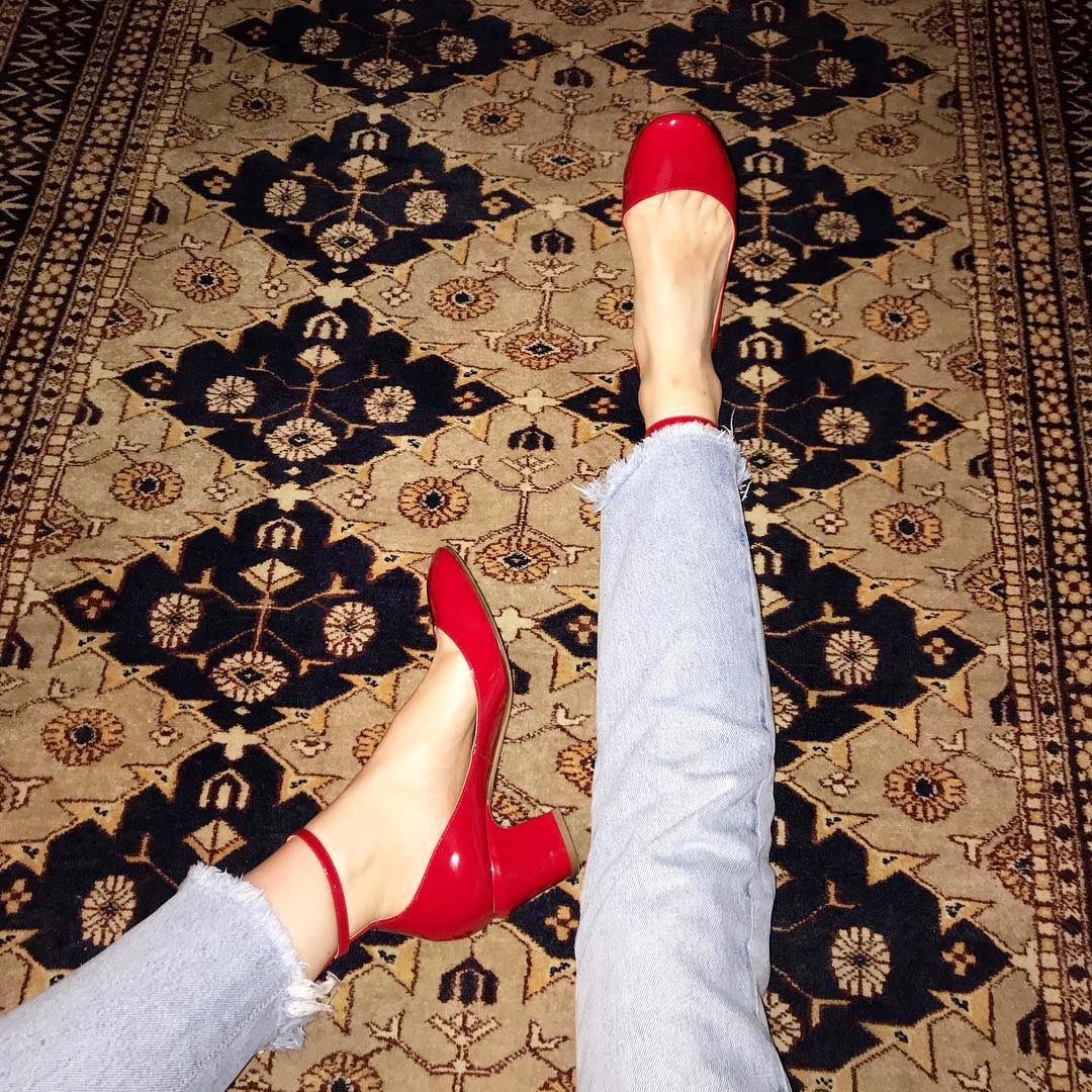 Betsy wearing red shoes on a magic carpet