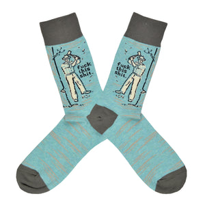 "These light blue cotton men's crew socks with a gray heel and toe by the brand Blue Q feature a man chopping down a tree, along with the text ""Fuck This Shit""."