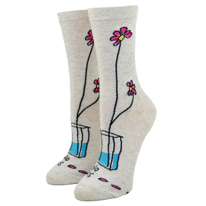 "Two dainty flowers are seen poking out of small vase on the backside of a ""Take no shit, give no fucks"" blue q women's cotton crew sock."
