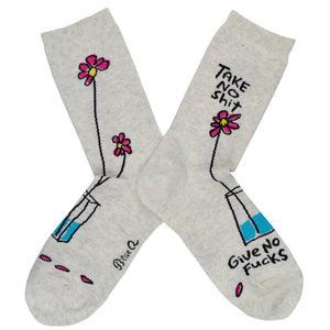 "A single dainty pink flower sits in a vase with the words ""take no shit"" written above it while ""give no fucks"" is followed on the foot of this women's white cotton Blue Q crew sock."