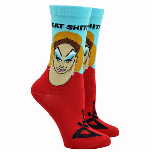 "Shown on a leg form, these blue and red cotton unisex crew socks feature a portrait of the legendary drag queen Divine and the words ""Eat Shit!"" below the cuff."