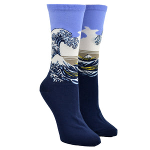 Shown on a leg form, these purple cotton women's crew socks by the brand Hot Sox feature the famous print The Great Wave by the Japanese artist Hokusai.