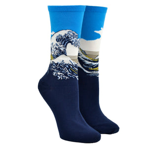 Shown on a leg form, these blue cotton women's crew socks by the brand Hot Sox feature the famous print The Great Wave by the Japanese artist Hokusai.